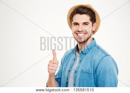 Happy young handsome man showing okay sign isolated on the white background
