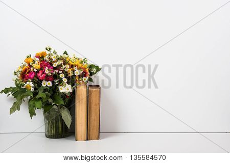 Interior home decor with flowers and books, simple summer decor with copyspace