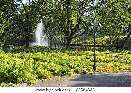 Small artificial waterfalls at Bastion Hill park in Riga Latvia. Empty walking lane. Front view. Have a place for text.