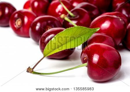 red cherry with leaf isolated on white background.