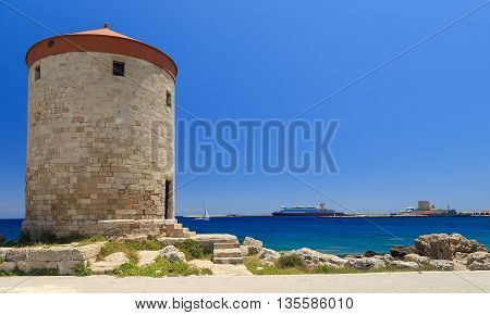 Mill Rhodes with cruise ship in the background sunny summer