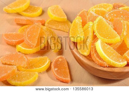 Orange And Lemon Candy Slices In A Bowl