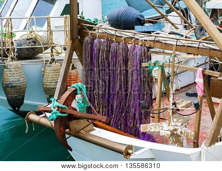 colorful floating nets of a fishing boat of Lake Varano Puglia. Italy
