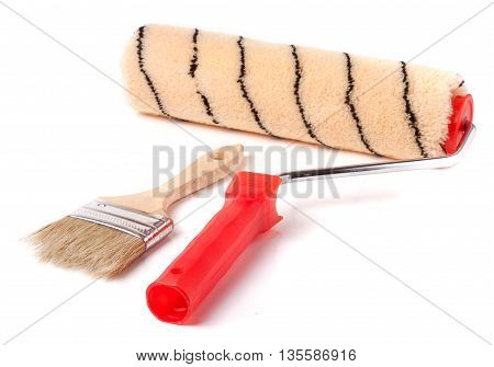 paint roller and brush on the white background.
