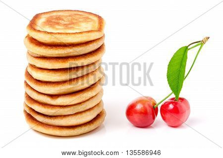Hill pancakes with cherry isolated on white background.