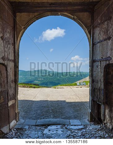 Suggestive panoramic view of the southern Apennines through the door of the Cattle castles. Puglia Italy.