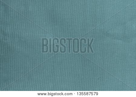 grained or speckled texture of pale blue color for abstract tone or for wallpaper