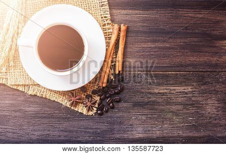 Cup of coffee and ears on dark wooden table background. top view with copy space