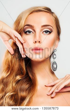 Blond Woman. Nice Face. Hair and Skin Care Concept. Beauty Fashion Portrait