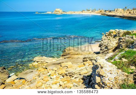 The sharp rocks in Caesarea are neighboring with the cozy sand beaches for those who came to enjoy the National Park Israel.
