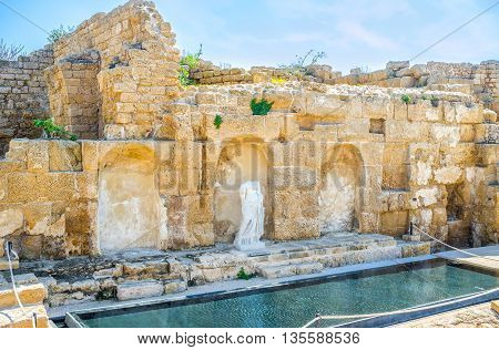One of the stone niche in the wall decorated with the broken antique statue Caesarea Israel.