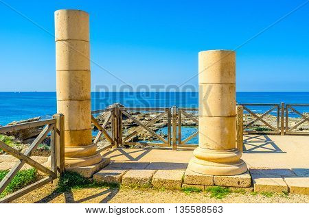 Two ancient columns since the Roman times guard the coast of Caesarea Israel.