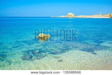 The coastal zone of Caesarea are covered with the rocks that can be seen in water Israel.