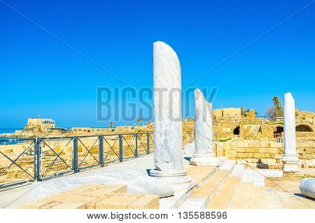 The white marble columns are the preserved elements of the ancient bathes important element of every roman settlement Caesarea Israel.