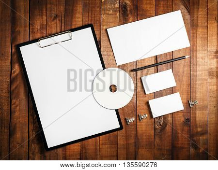 Blank corporate identity template on vintage wooden background. Photo of blank stationery set. Mock-up for your design. Top view.