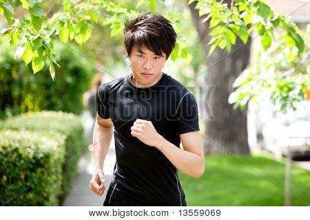 Serious man jogging