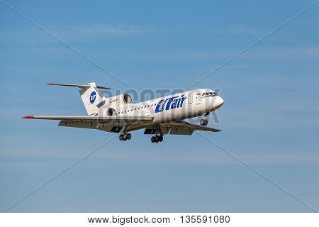 VNUKOVO, MOSCOW REGION, RUSSIA - 02 July, 2013: Airplanes at Vnukovo international airport. Utair Airlines Yak-42 landing on runway