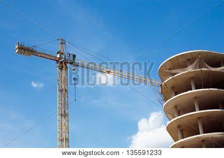 stopped construction of high-rise building. construction crane and unfinished high house