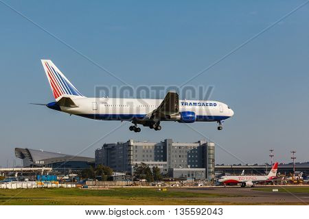 VNUKOVO, MOSCOW REGION, RUSSIA - 21 August, 2013: Airplanes at Vnukovo international airport. Transaero Airlines Boeing 777 landed to runway