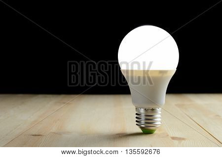 Led Lamp Standing On A Wooden Table