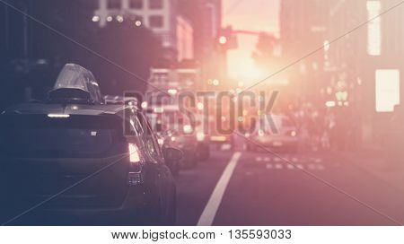 Beautiful sunset along a New York street blurred background with filtered light leak
