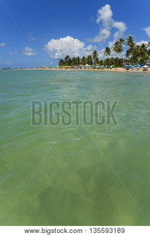 Tropical beach coast landscape view from ocean water surface summer vacation background.