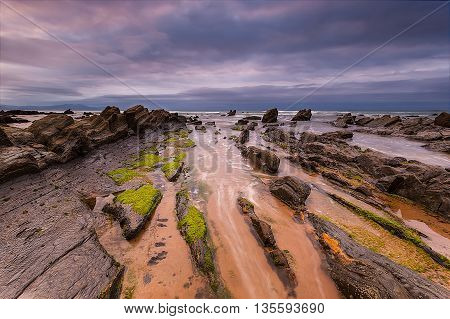 Cloudy sunset at Barrika beach, in Bizkaia
