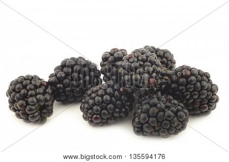 bunch of fresh blackberries on a white background