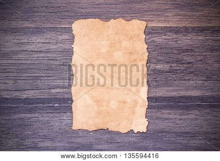 Old paper on dark wooden table background. top view with copy space