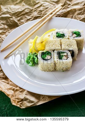 Rolls And Wasabi On White Plate.