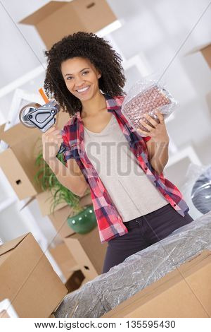 woman holding roll of adhesive tape