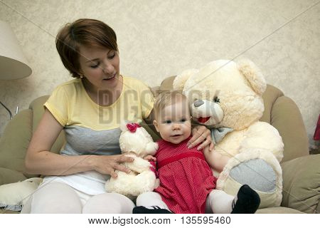 Small Cute Baby And Mom In The Room