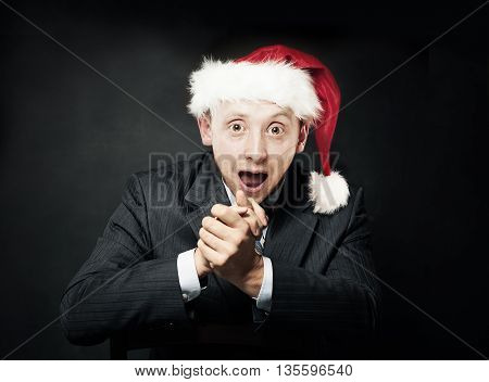 Businessman with Open Mouth. Delight and Fun. Surprised Business Man in Christmas Santa Hat on Dark Background