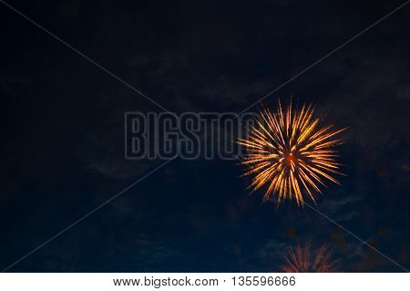 Fireworks In The Evening Sky With Majestic Clouds, Long Exposure