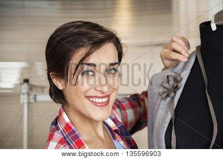 Happy Fashion Designer Fixing Suit On Mannequin