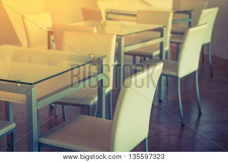 Tables and chairs in restaurant ( Filtered image processed vintage effect. )