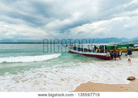 GILI MENO, INDONESIA - May 6, 2013 - Tourists boarding boat island hopping