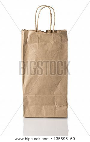 A brown paper bag possibly for alcohol facing forward isolated on white with reflection.