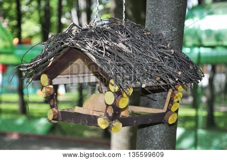 a bird feeder in a rustic cottage