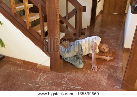 Senior man fell down the stairs onto marble floor