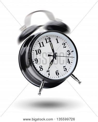 Ringing black alarm clock isolated on white background