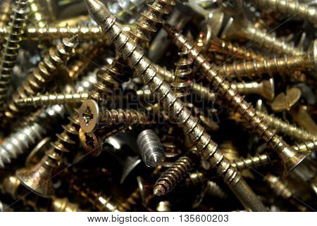 Collection of gold and silver metal screws