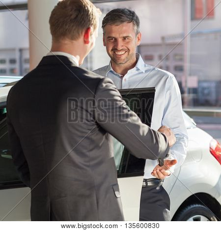 Mature man buying a new modern car