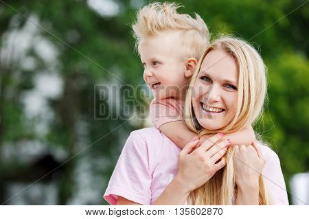 Mom playing with his son in the park