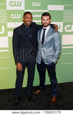 NEW YORK, NY - MAY 14: Actors Charles Michael Davis (L) and Daniel Gillies attend the 2015 CW Network Upfront Presentation at the London Hotel on May 14, 2015 in New York City.