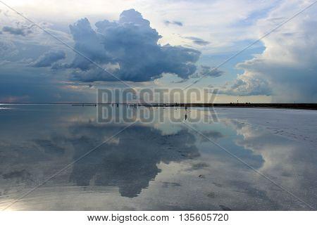 Mirror-like Elton lake, biggest salt lake in Europe, Russia