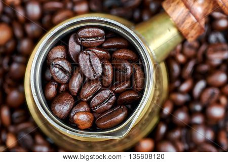 Coffee beans in a turkish coffee pot