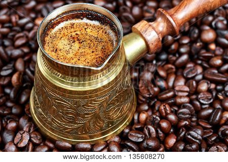 Hot black coffee in a traditional coffee pot