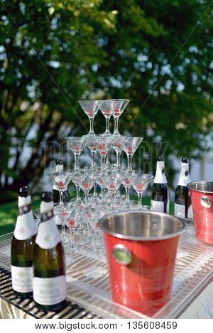 Beautiful Wedding Slide Champagne For Bride And Groom Indoors. Colorful Glasses For Alcohol With Ber