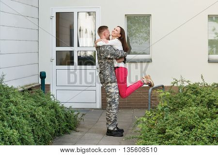 Young Happy Wife Welcoming Her Husband From Army Leave
